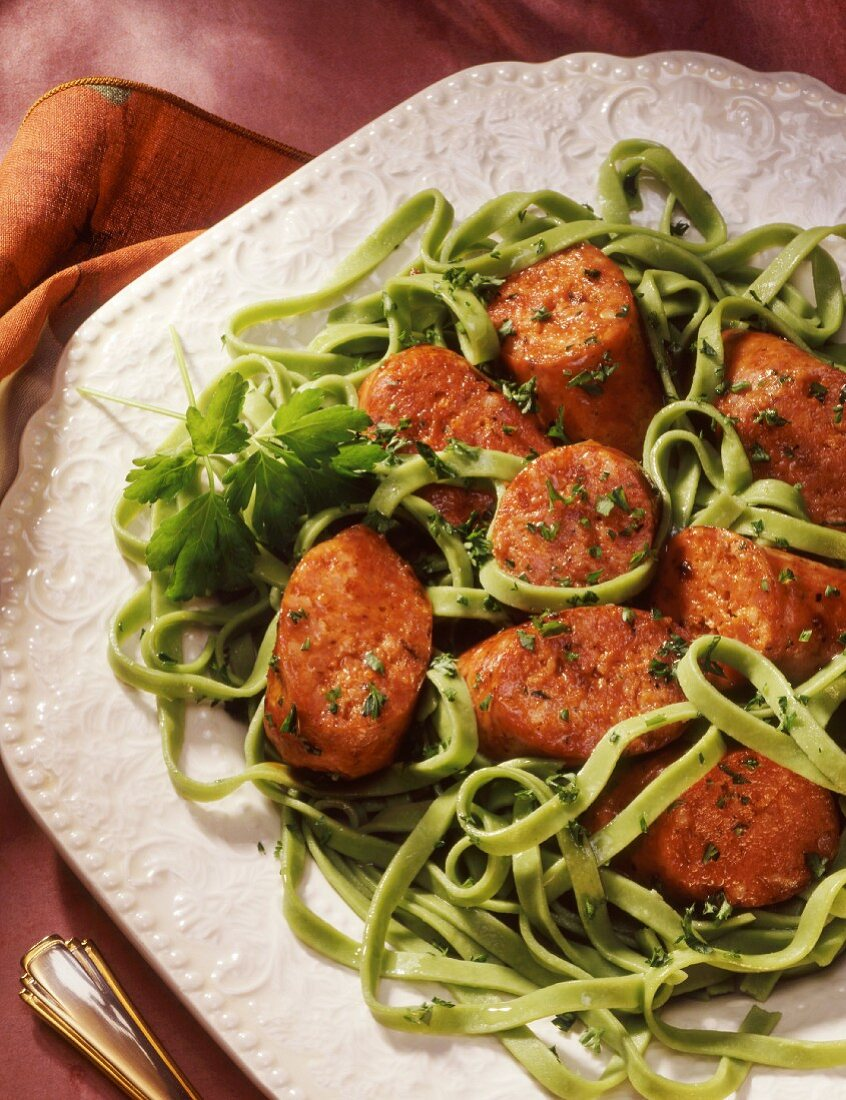 Sausage and spinach pasta with parsley