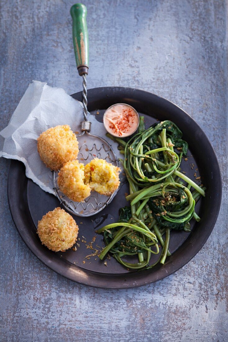 Water spinach with fried rice balls