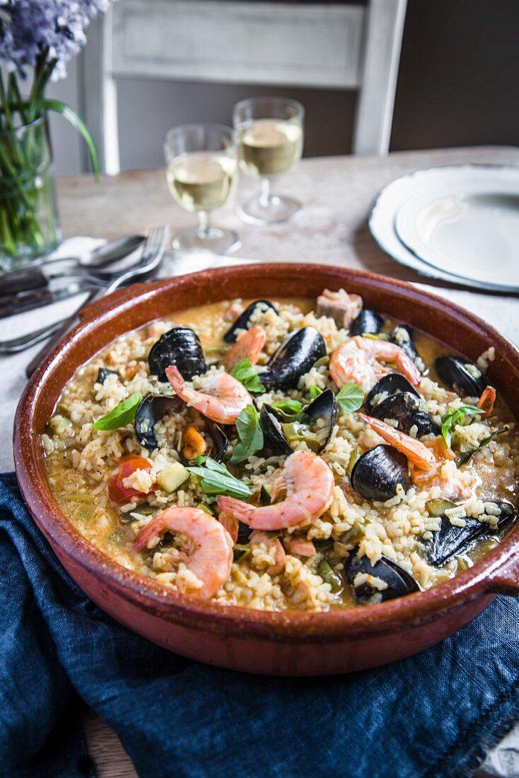 Seafood paella in a large terracotta dish