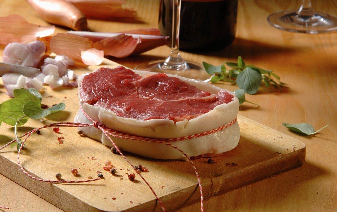 Raw beef fillet steak wrapped in bacon