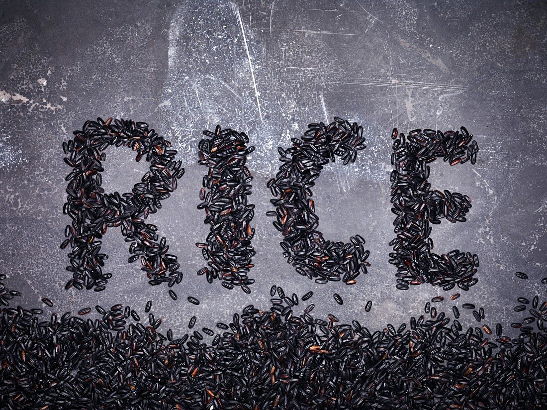 Black rice spelling the word 'Rice'