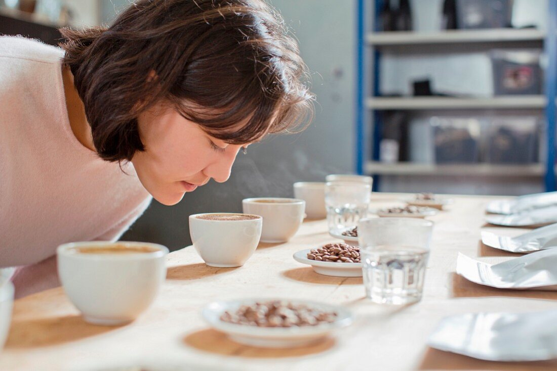 A coffee taster sniffing freshly brewed coffee