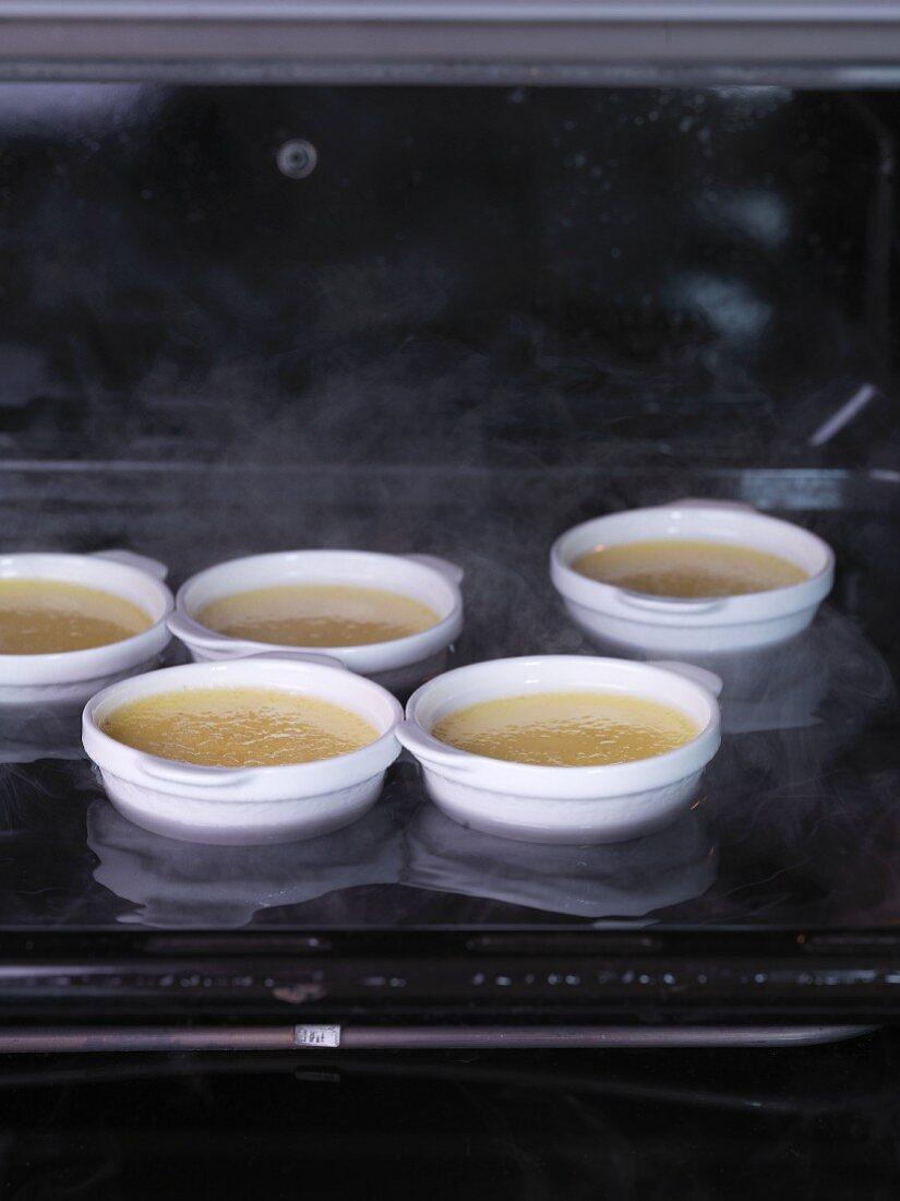 Crème brûlée setting in a bain-marie