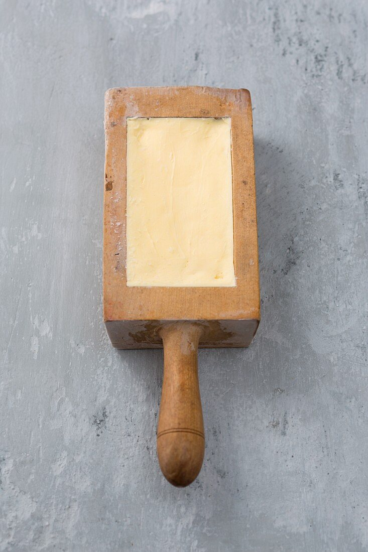 Butter in a wooden pat