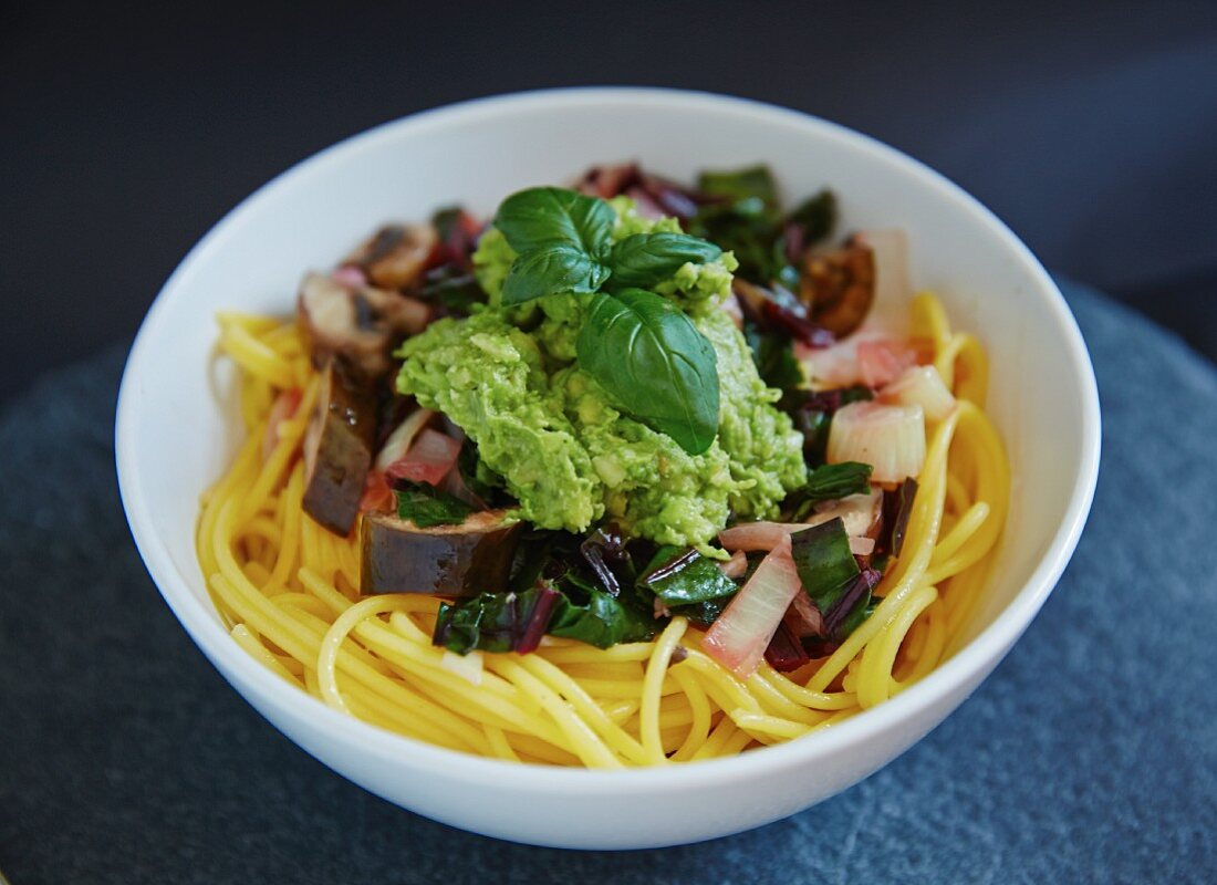 Gluten-free pasta with avocado, chard and aubergines