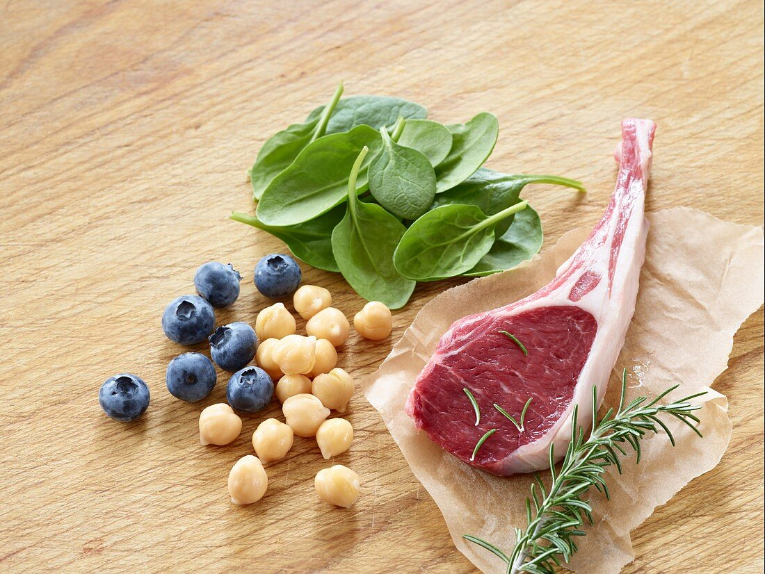 A lamb chop with blueberries, chickpeas, rosemary and spinach
