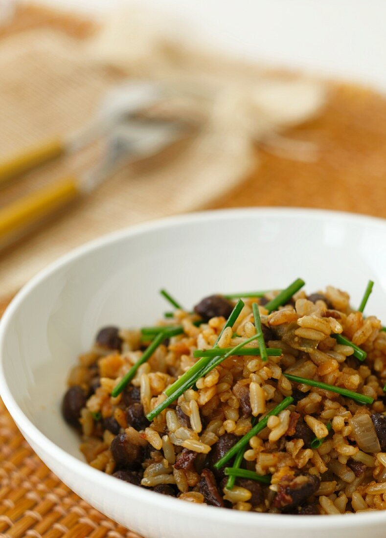 A bowl of natural rice with black beans and chives