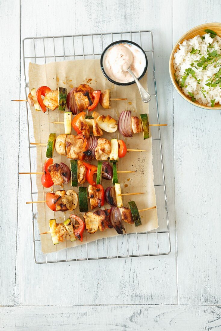 Chicken and vegetable kebabs with a spicy yoghurt dip