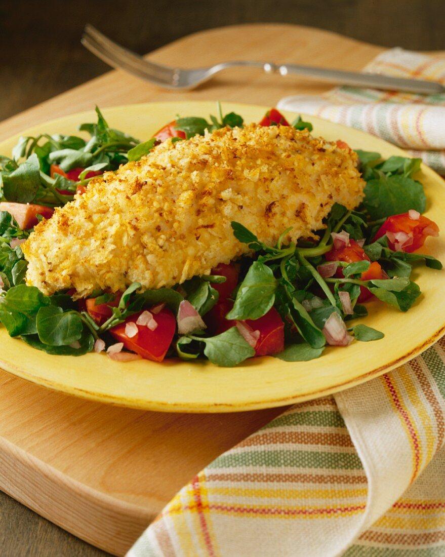 Breaded haddock on a mixed salad