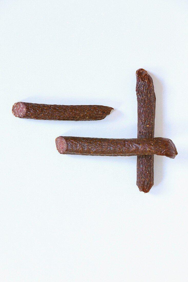 Three Cananossi sausages