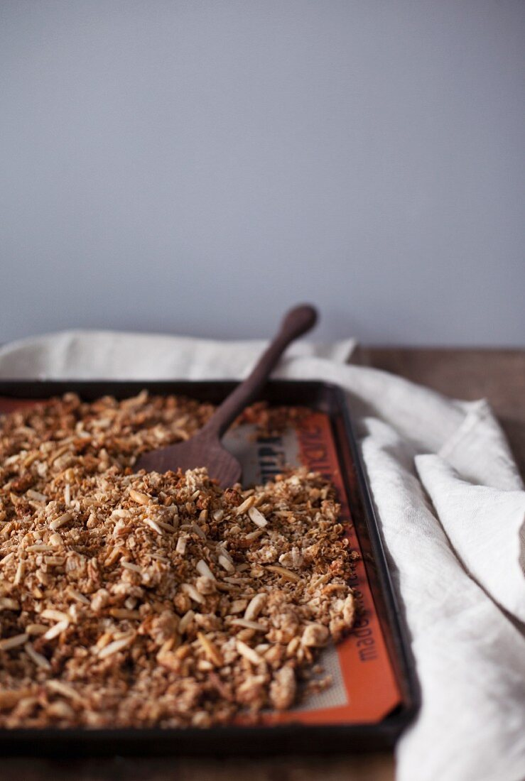Homemade almond and coconut granola on a baking tray