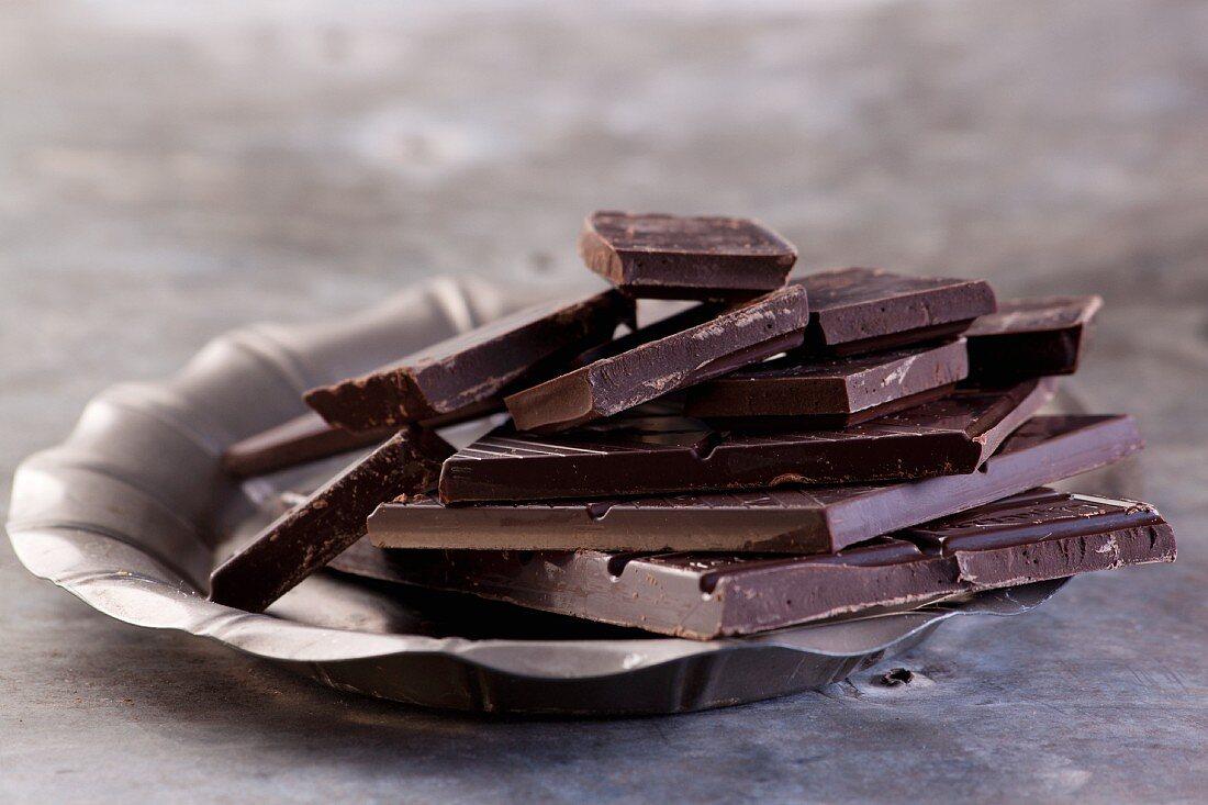 Broken bars of dark chocolate