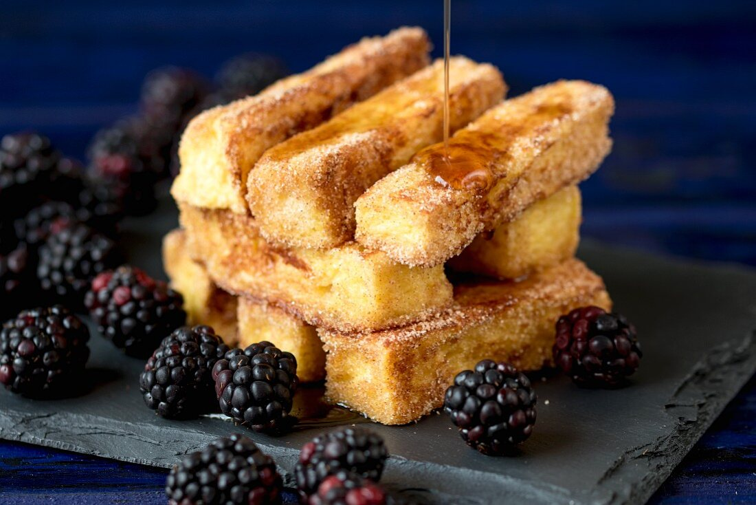 Honey being drizzled over French toast