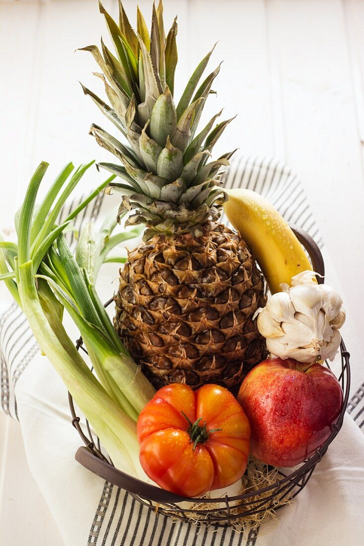 Fruit and vegetables in a wire basket