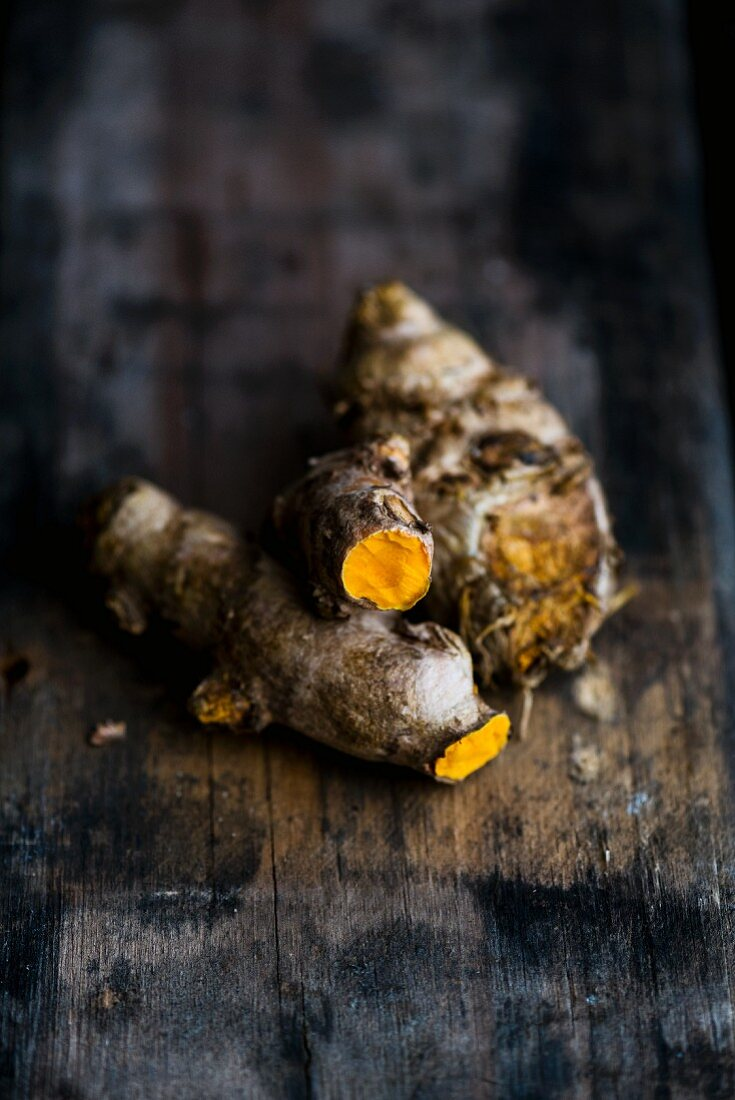 Turmeric roots on a wooden surface