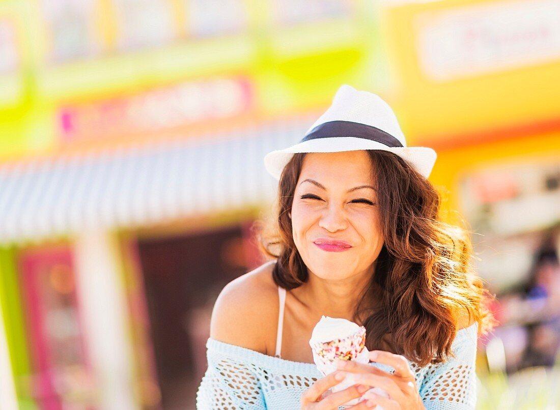 An Oriental woman holding an ice cream cone