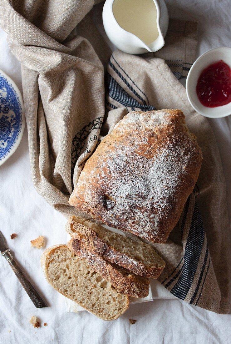 Homemade ciabatta bread, sliced (seen above)