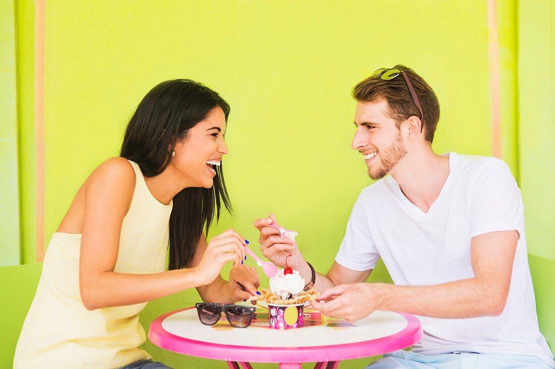 A couple sharing an ice cream sundae