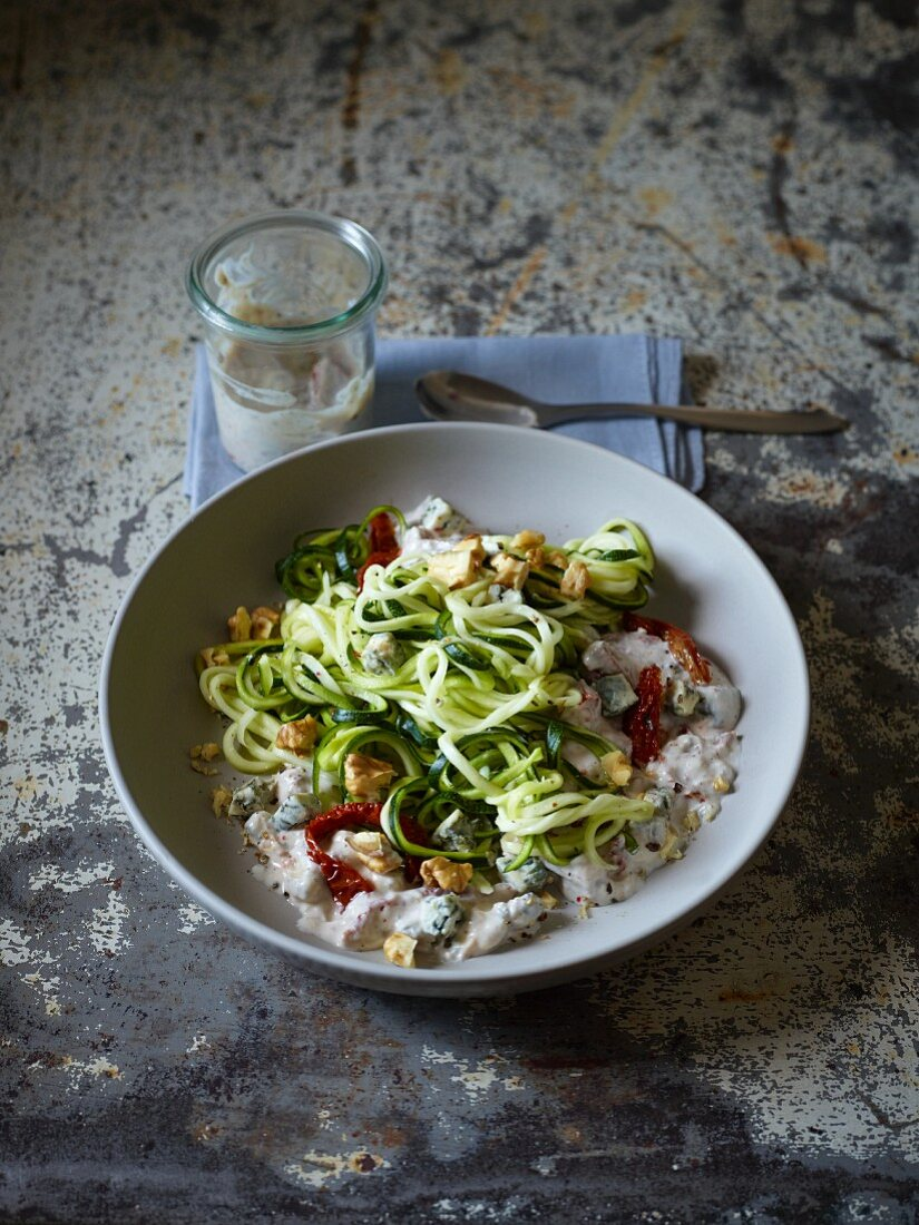 Courgette spiral salad with dried tomatoes and nuts