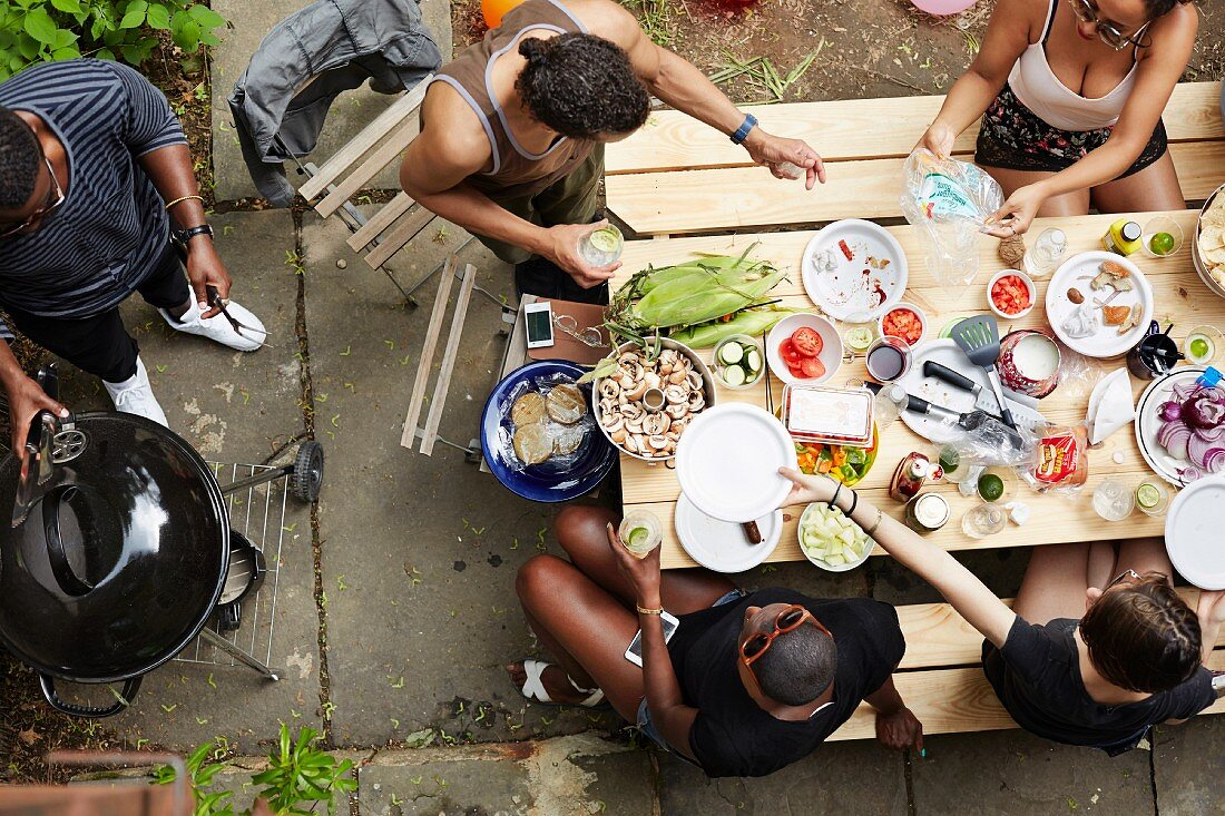 A group of young people having a barbecue in a courtyard (seen from above)
