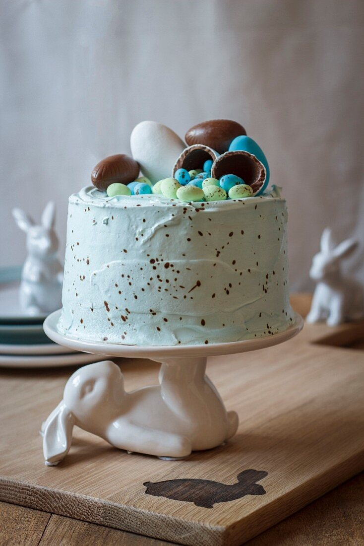 A sprinkled vanilla cake with filled with marshmallows and easter eggs