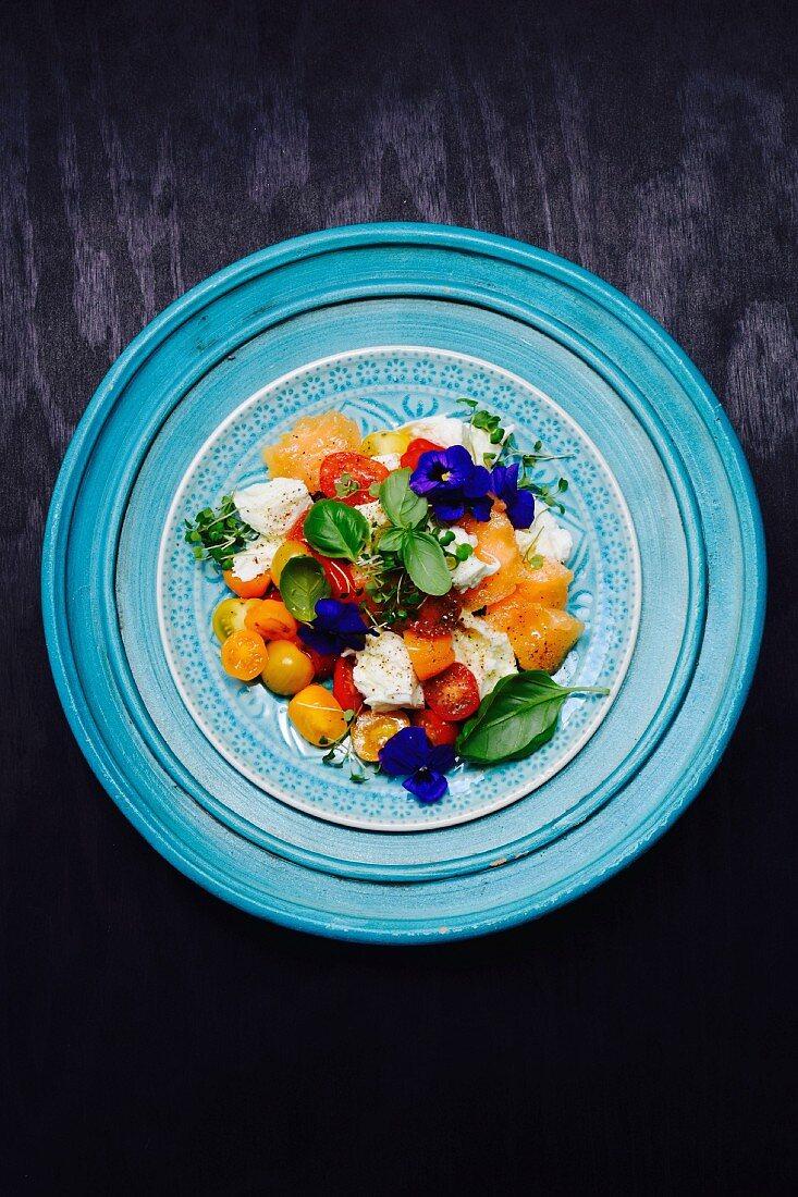 Tomato and mozzarella salad with melon