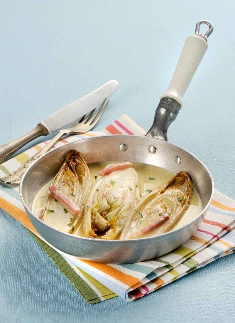 Braised chicory in a white wine sauce