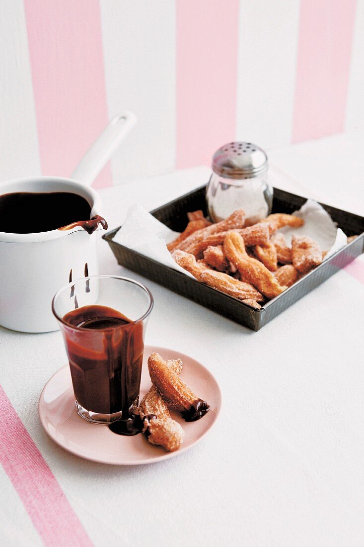 Churros (fried-dough pastry from Spain) with warm chilli and chocolate sauce