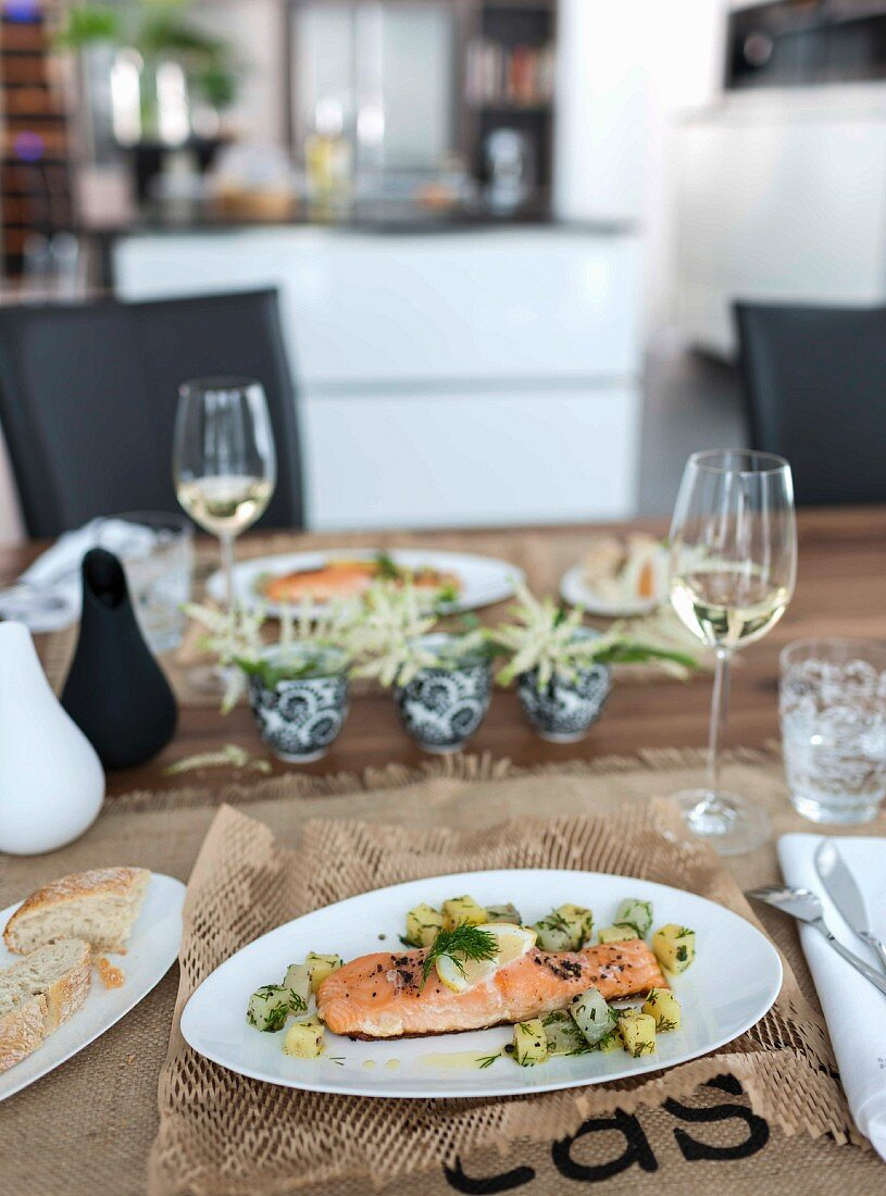 Salmon fillet with a kohlrabi and potato medley on a brown place mat
