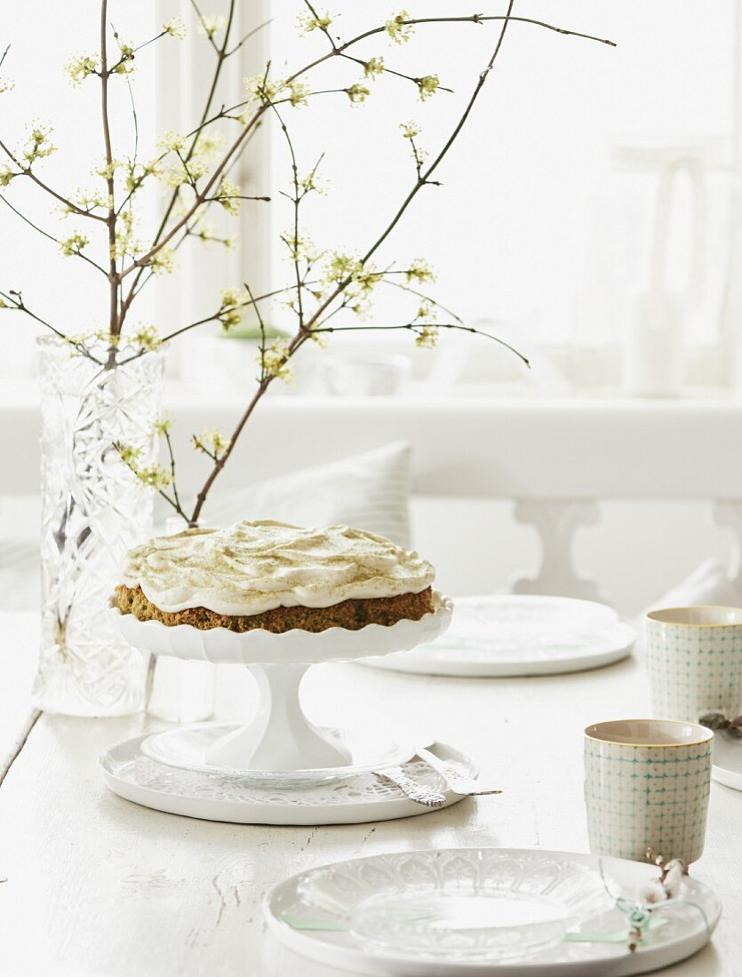Coconut and carrot cake with cream cheese topping on a coffee table