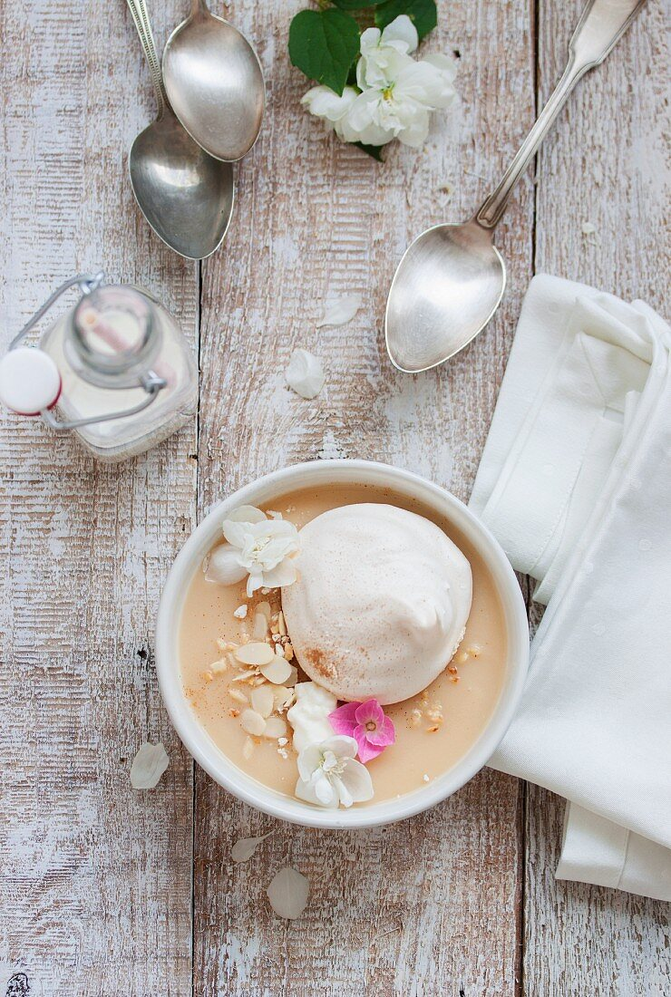 Estonian apple soup with meringue, cream and almonds