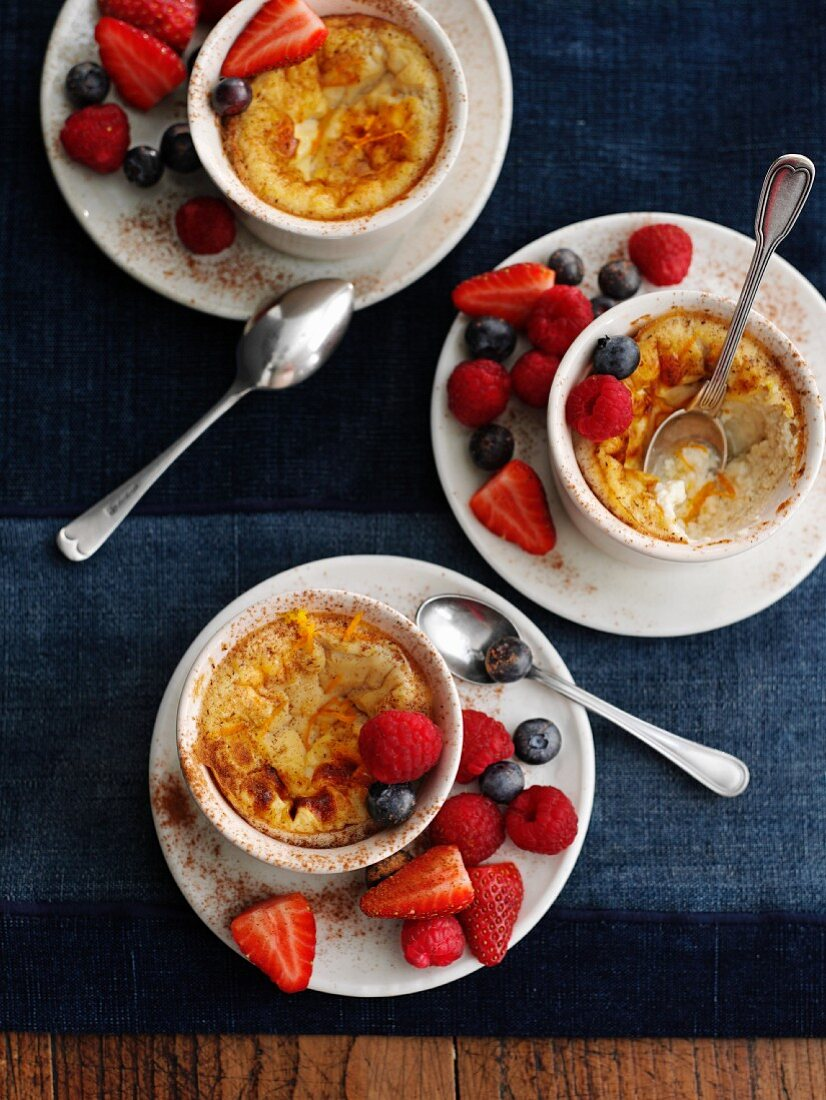 Baked egg custard with berries (England)