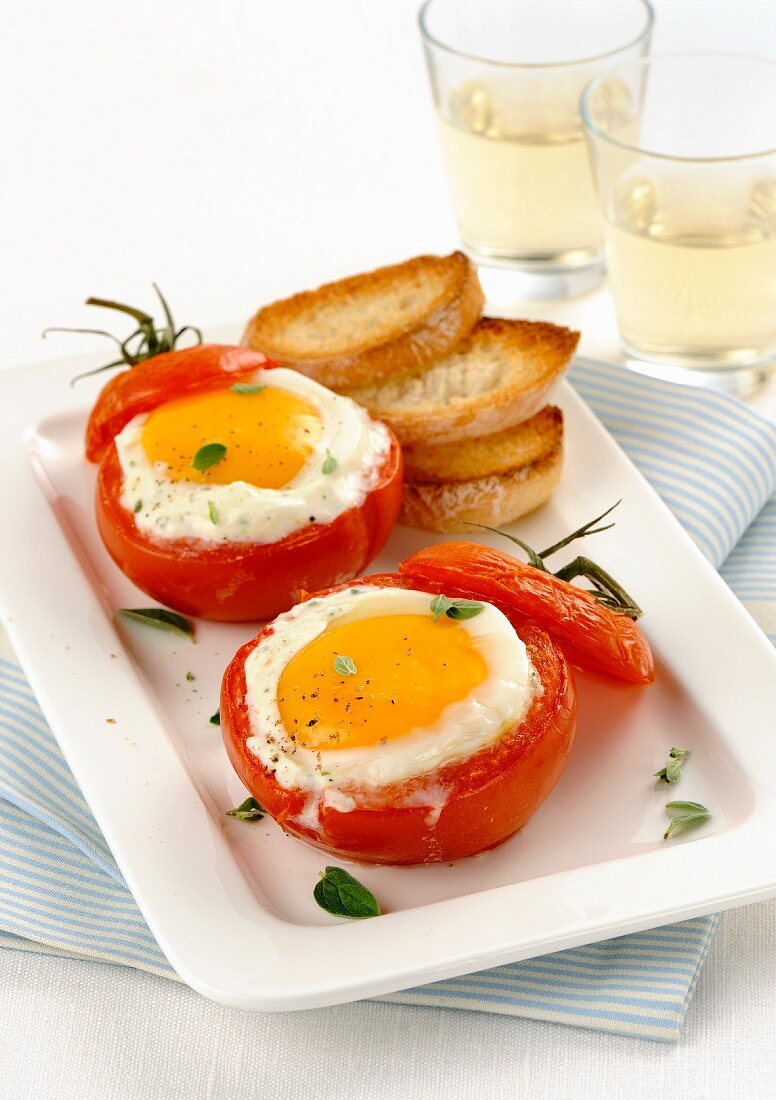 Tomatoes with fried eggs