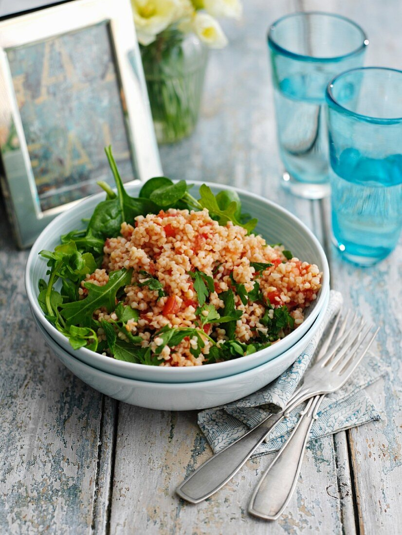 Tabbouleh salad with tomato and rocket