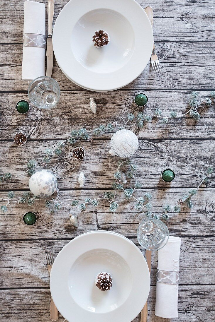 Two place settings on Christmas table