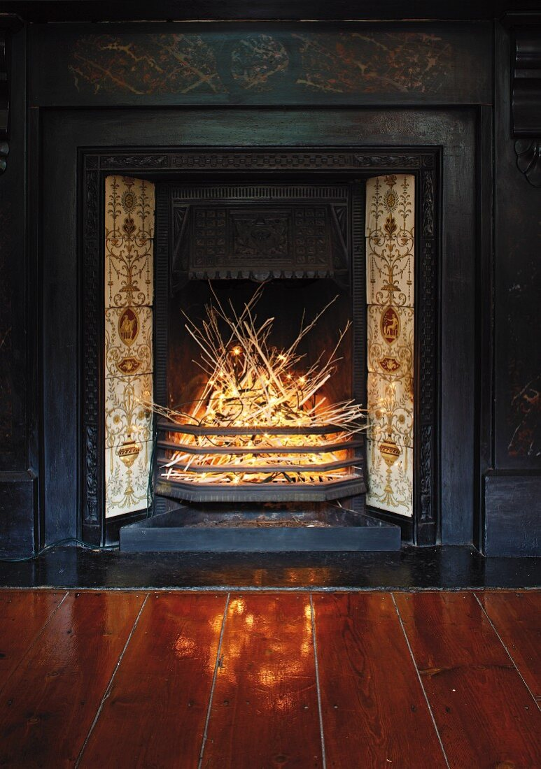 Arrangement with fairy lights in disused fireplace