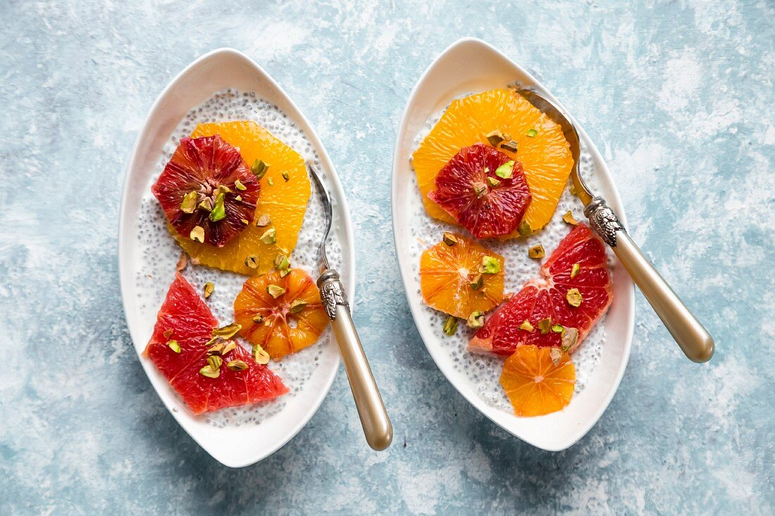 Chia pudding with orange and grapefruit slices in bowls
