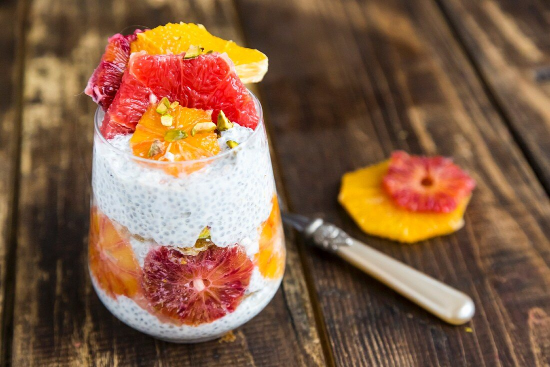 Chia pudding with orange and grapefruit slices in a glass