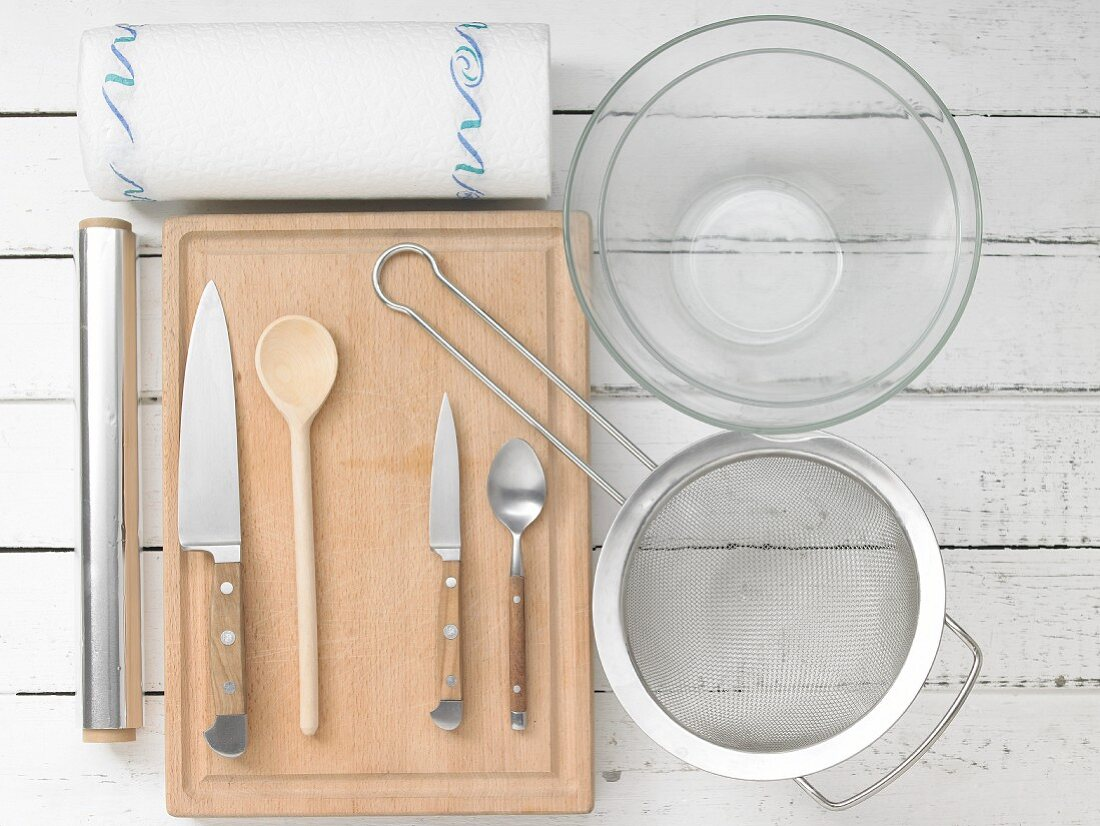 Kitchen utensils for making a grilled dish with vegetables and cheese in aluminium foil
