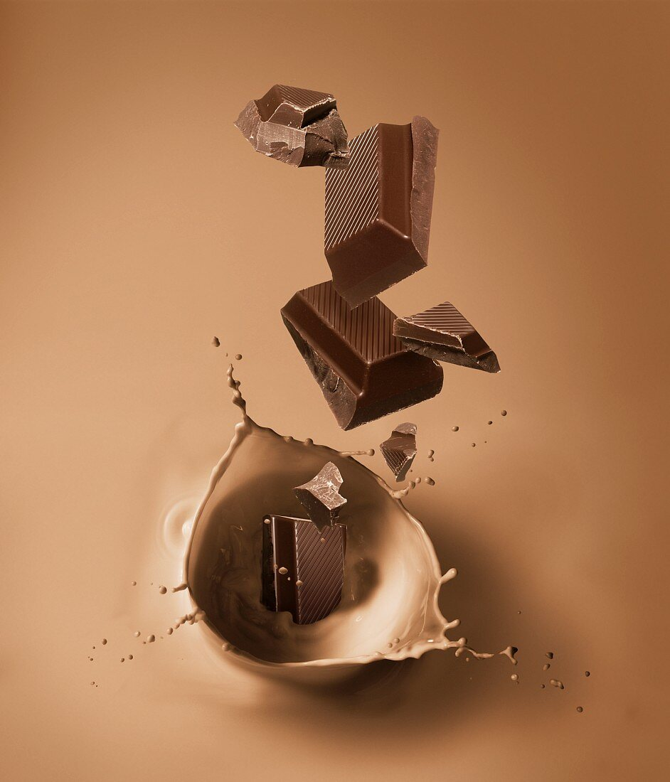 Pieces of chocolate falling into chocolate milk