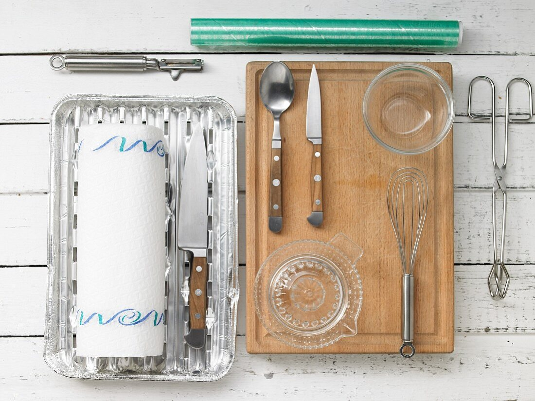 Kitchen utensils for preparing grilled lamb chops and potatoes