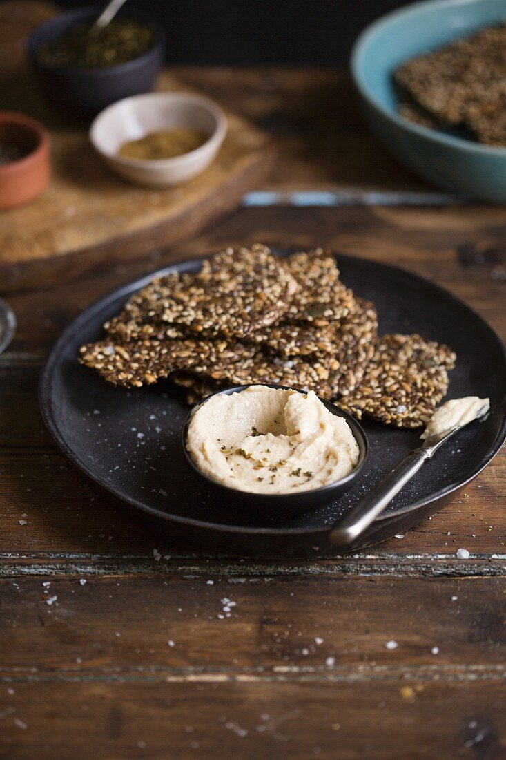 Homemade gluten-free seeded crackers with hummus