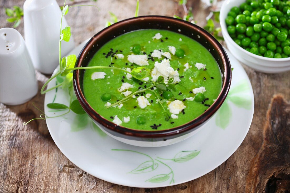Cream of pea soup with cheese and black sesame seeds