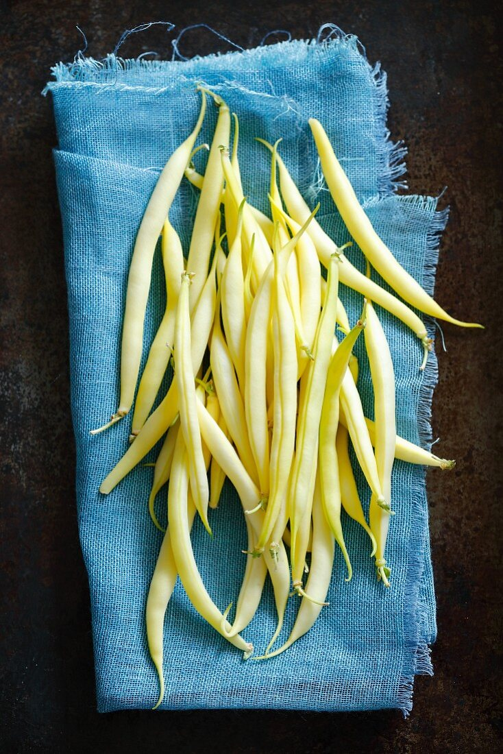 Fresh yellow beans on a cloth (seen from above)