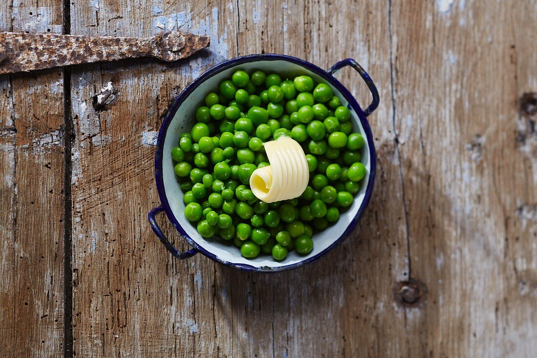 Peas with butter in a pot