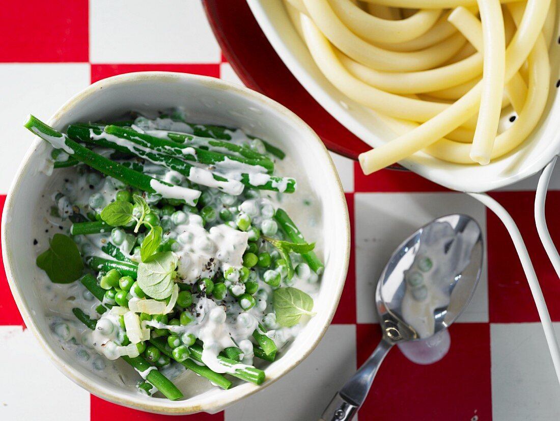 Pea and bean ragout with soya cream and Grana Padano