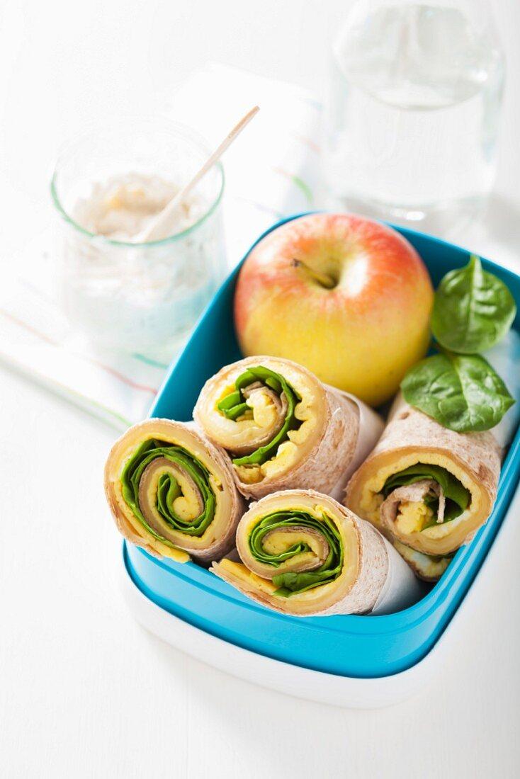 Breakfast burritos in a lunch box