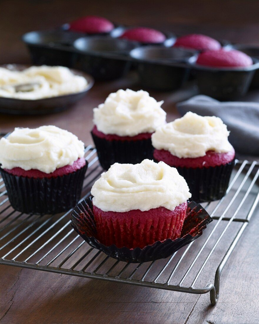 Beetroot cupcakes on a cooling rack