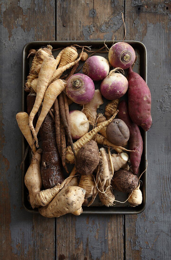 Assorted root vegetables on a baking tray