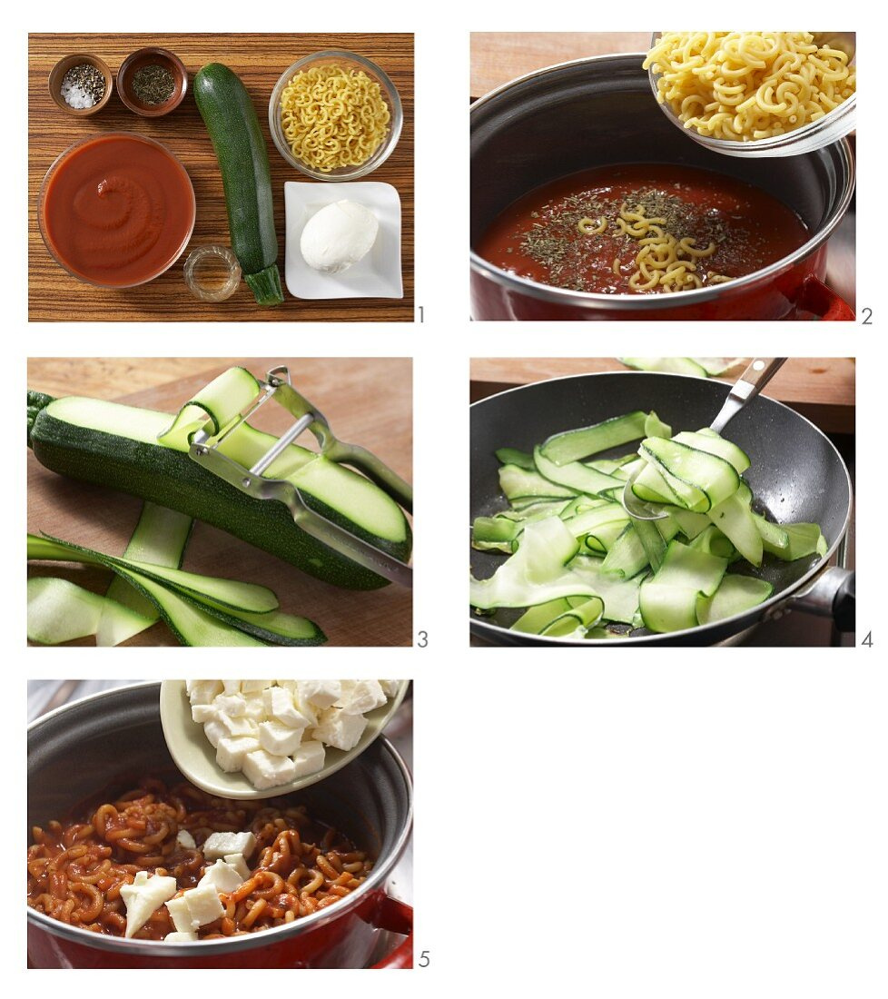 Short spaghetti with tomato sauce, courgettes and mozzarella being made